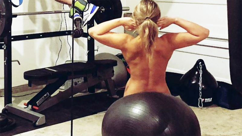 Nude exercising on total gym